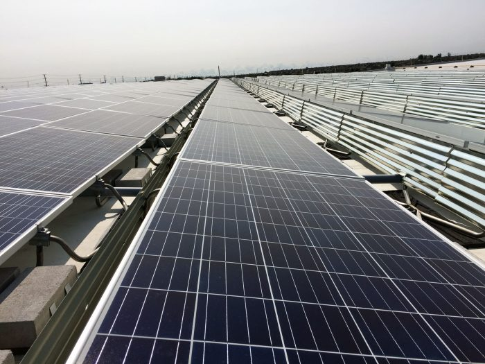 Ballasted flat roof system grid based